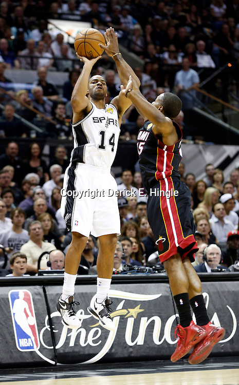 Jun 13, 2013; San Antonio, TX, USA; San Antonio Spurs point guard Gary Neal (14) shoots against Miami Heat point guard Mario Chalmers (15) during the first quarter of game four of the 2013 NBA Finals at the AT&T Center. Mandatory Credit: Derick E. Hingle-USA TODAY Sports