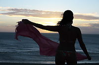 beautiful  bikini dressed young brazilain  woman in jericoacoara at the sunset ceara state near fortaleza