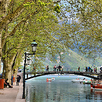 Pont des Amours over Vassé Canal in Annecy, France <br /> I was delighted to learn this quaint bridge over the Vassé Canal next to Lake Annecy is called Pont des Amours, or Bridge of Lovers, until I learned the nickname was derived from its 20th century reputation as a rendezvous point for prostitutes. Ah, the romance returned, however, when I was told if you kiss your lover at the mid-point of the cast iron bridge, you will remain together forever.