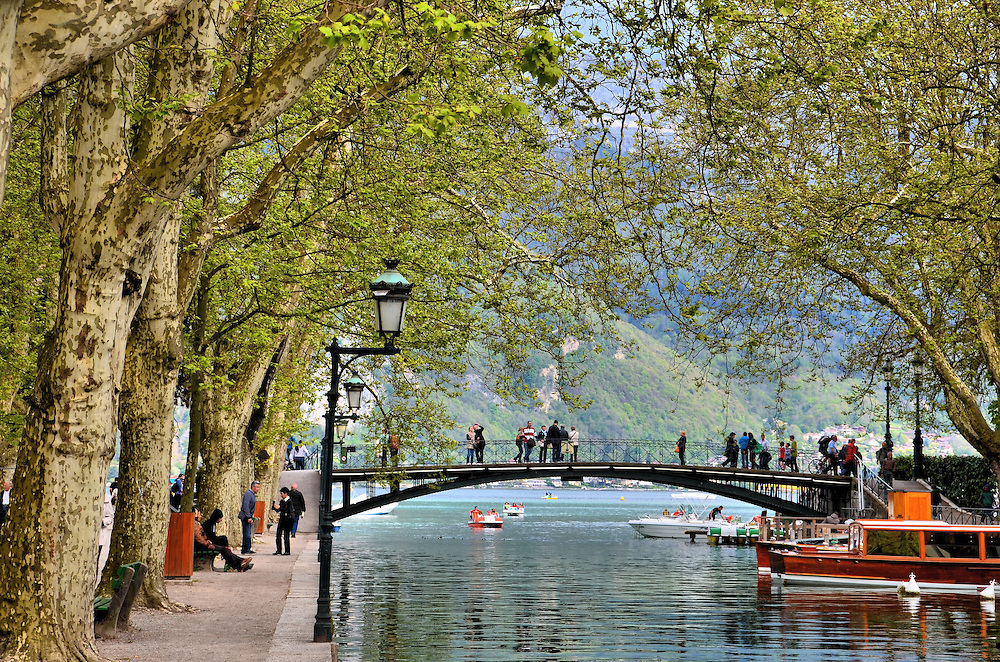 Pont des Amours over Vass&eacute; Canal in Annecy, France <br /> I was delighted to learn this quaint bridge over the Vass&eacute; Canal next to Lake Annecy is called Pont des Amours, or Bridge of Lovers, until I learned the nickname was derived from its 20th century reputation as a rendezvous point for prostitutes. Ah, the romance returned, however, when I was told if you kiss your lover at the mid-point of the cast iron bridge, you will remain together forever.
