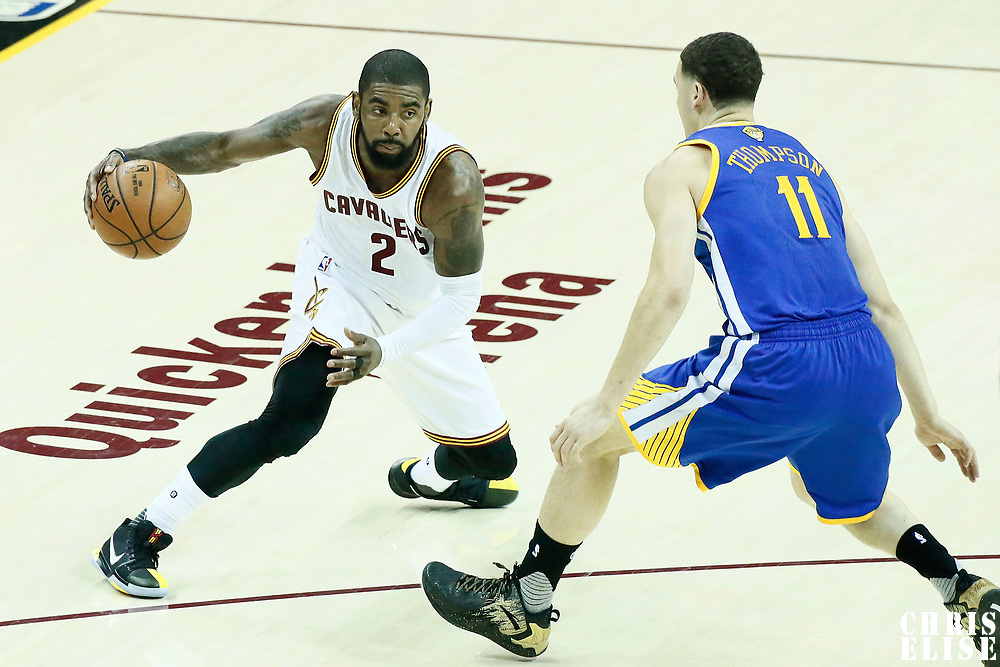 07 June 2017: Golden State Warriors guard Klay Thompson (11) defends on Cleveland Cavaliers guard Kyrie Irving (2) during the Golden State Warriors 118-113 victory over the Cleveland Cavaliers, in game 3 of the 2017 NBA Finals, at  the Quicken Loans Arena, Cleveland, Ohio, USA.