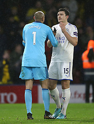 """Watford goalkeeper Heurelho Gomes and Leicester City's Harry Maguire after the Premier League match at Vicarage Road, Watford. PRESS ASSOCIATION Photo. Picture date: Tuesday December 26, 2017. See PA story SOCCER Watford. Photo credit should read: Scott Heavey/PA Wire. RESTRICTIONS: EDITORIAL USE ONLY No use with unauthorised audio, video, data, fixture lists, club/league logos or """"live"""" services. Online in-match use limited to 75 images, no video emulation. No use in betting, games or single club/league/player publications."""