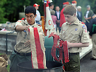 CHURCHVILLE, PA - JUNE 14: Tyler Andre (L), 15, and James Murray, 14 of Boy Scout Troop 5 of Churchville place the stripes from an American flag into a separate fire to properly dispose of American flags during a ceremony June 14, 2014 at Northampton Township Municipal Park in Churchville, Pennsylvania. The Northampton supervisors and Veterans Advisory Committee held the ceremony in which people brought their old or tattered American flags for proper disposal.  (Photo by William Thomas Cain/Cain Images)