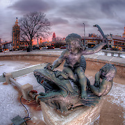 Stepping around inside the JC NIchols Fountain empty of water in winter, Mill Creek Park, Country Club Plaza, Kansas City, Missouri.