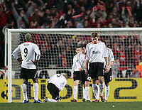 Photo: Lee Earle.<br /> Benfica v Liverpool. UEFA Champions League. 2nd Round, 1st Leg. 21/02/2006. Liverpool's Steven Gerrard (R) and Djibril Cisse (L) look dejected after Benfica scored.