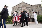 Navy Radioman 2nd Class Quentin Gifford is carried out of Fort Snelling Memorial Chapel to be buried with full Naval honors 76 years after his death at Pearl Harbor. (Courtney Perry for MPR)
