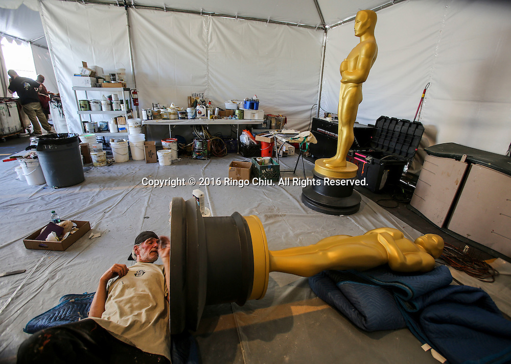 Sam Costa works on an Oscar statue at a Hollywood back lot near the Dolby Theatre Feb. 25, 2016 in Los Angeles. The 88th Academy Awards will be held Sunday, February 28, 2016. (Photo by Ringo Chiu/PHOTOFORMULA.com)<br /> <br /> Usage Notes: This content is intended for editorial use only. For other uses, additional clearances may be required.