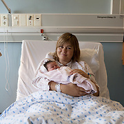 Oslo, Norway, August 27, 2012. Ulleval Ullevål Hospital, Maternity Ward. Anne, 38 with her first daughter Ingeborg.