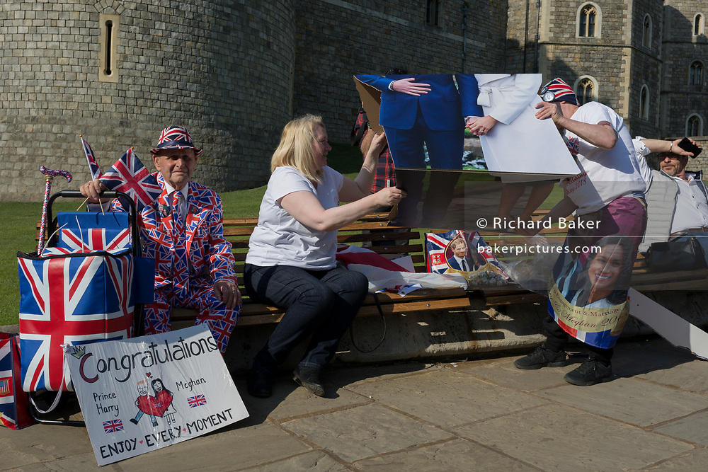 Royalists occupy benches outside Windsor Castle with a life-size standee of Prince Harry and Meghan Markle as the royal town gets ready for the royal wedding between Harry and his American fiance, on 14th May 2018, in London, England. (Photo by Richard Baker / In Pictures via Getty Images)