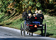 Amish family in horse drawn buggy, Ronks, Lancaster County, Pennsylvania, USA