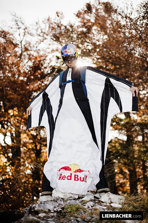 Red Bull Skydive Team member Marco Waltenspiel is posing for a portrait wearing his wingsuit next to the exit of the Drachenwand in Mondsee.