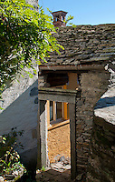 Old stone portal in Auressio in the Valle Onsernone in Ticino, Southern Switzerland.