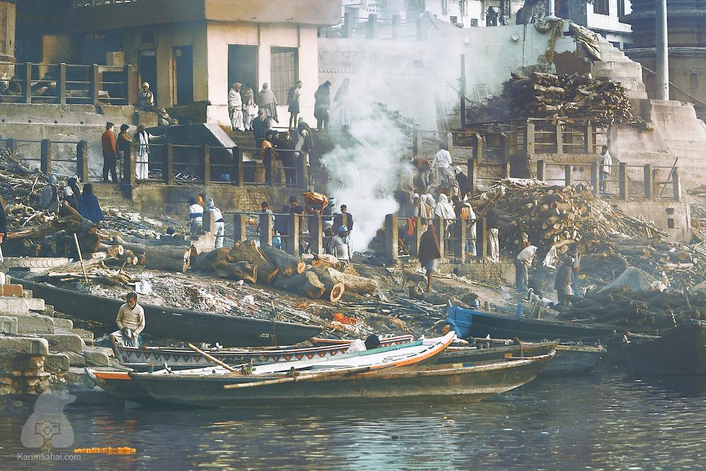 Smoke rises from funeral pyres at Manikarnika Ghat, Varanasi, Uttar Pradesh, India.