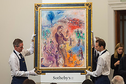 © Licensed to London News Pictures. 26/02/2019. LONDON, UK. ''Le Peintre À La Fête '' by Marc Chagall, (Est. £1,000,000 - 1,500,000) sold for a hammer price of £1,450,000 at Sotheby's Impressionist, Modern and Surrealist Art Evening Sale in New Bond Street.  Photo credit: Stephen Chung/LNP