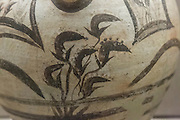 Flowers on a vase  from the archaeological site of Akrotiri, that was covered by volcanic ash in 1627 BC, Santorini, Greece.