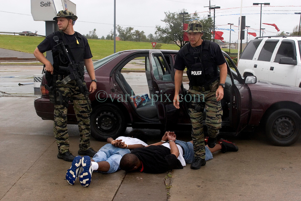 24 Sept, 2005.  Beaumont, Texas. Hurricane Rita. <br /> <br /> Police from the Beaumont rapid reaction force arrest looters who they captured breaking into a Chevron petrol station just off interstate 10.<br /> Photo; ©Charlie Varley/varleypix.com
