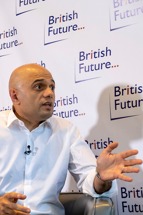 Sajid Javid MP discussing the challenges of identity in British society today, in conversation with Sunder Katwala, Director of thinktank British Future at The Royal Society London, United Kingdom, 6th June 2019.  Home Secretary Sajid Javid is the first British Asian politician to hold one of the great offices of state. He has declared that he will be a candidate to be the next Prime Minister in the forthcoming Conservative leadership election. (photo by Andy Aitchison)