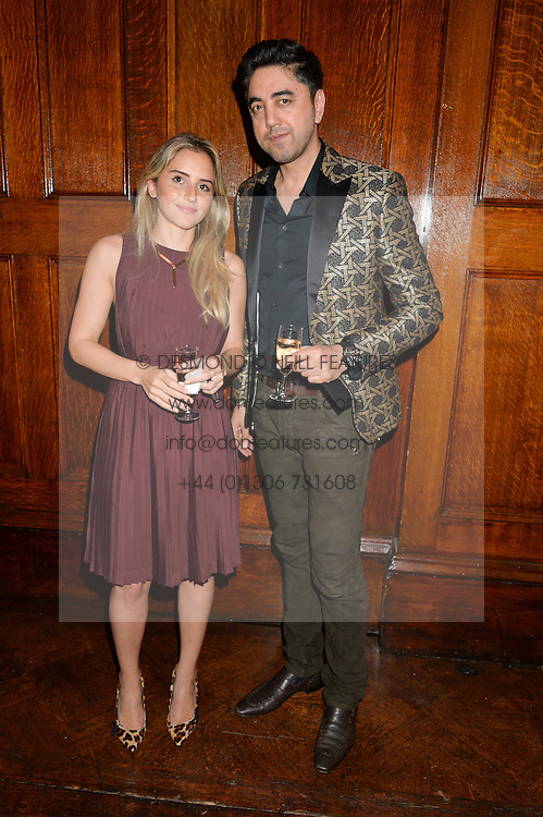 LAURA TANNOUS and NAEEM TYAB at a party to celebrate opening of Galerie Kreo in London held at Il Bottaccio, Grosvenor Place, London on 17th September 2014.