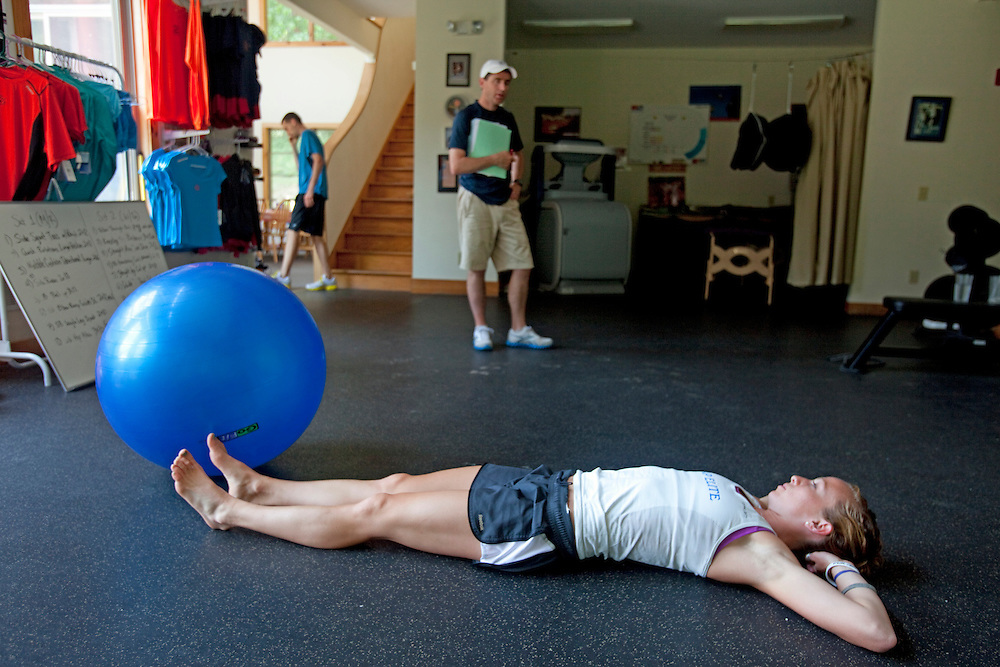 Zap Fitness athlete Esther Erb chats with Pete Rea, elite athlete coordinator, during a workout session at the Zap training facility in Blowing Rock, NC..