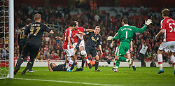 LONDON, ENGLAND - Wednesday, October 28, 2009: Liverpool's goalkeeper Diego Cavalieri and Jay Spearing challenges Arsenal's Mikael Silvestre during the League Cup 4th Round match at Emirates Stadium. (Photo by David Rawcliffe/Propaganda)