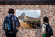 Couple  watching a photograph on tiles of Korean soldiers during the cherry blossom festival in Jinhae.