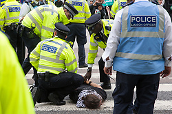 London, UK. 2 September, 2019. Police officers arrest a male activist who had locked on using an arm tube to block a road outside ExCel London on the first day of week-long protests against DSEI 2019, the world's largest arms fair. The first day of creative action was hosted by activists calling for a ban on arms exports to Israel and featured workshops, speakers, street theatre and dance. Israeli arms companies display weapons at DSEI marketed as 'combat-proven' following deployment against Palestinian communities.