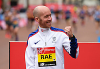 Derek Rae GBR celebrates on the podium after finishing second on the T46 Men World Para Athletics Marathon Championships. The Virgin Money London Marathon, 28 April 2019.<br /> <br /> Photo: Joe Toth for Virgin Money London Marathon<br /> <br /> For further information: media@londonmarathonevents.co.uk