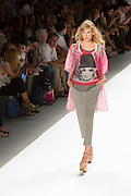 Gray open-weave pants, a print knit top with a gray netting over laver, and a jacket. By Custo Barcelona at the Spring 2013 Fashion Week show in New York.