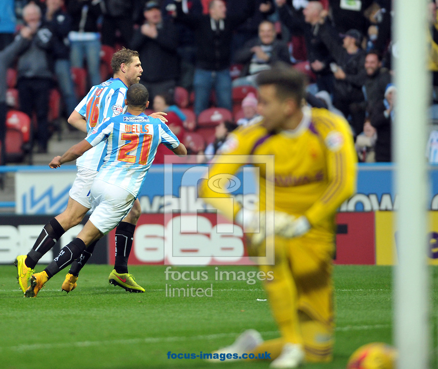 Grant Holt of Huddersfield Town scores a 3rd goal against Nottingham Forest during the Sky Bet Championship match at the John Smiths Stadium, Huddersfield<br /> Picture by Graham Crowther/Focus Images Ltd +44 7763 140036<br /> 01/11/2014