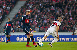 December 16, 2017 - Stuttgart, Germany - Bayerns Robert Lewandowski in a duel with Stuttgarts Andreas Beck during the German first division Bundesliga football match between VfB Stuttgart and Bayern Munich on December 16, 2017 in Stuttgart, Germany. (Credit Image: © Bartek Langer/NurPhoto via ZUMA Press)