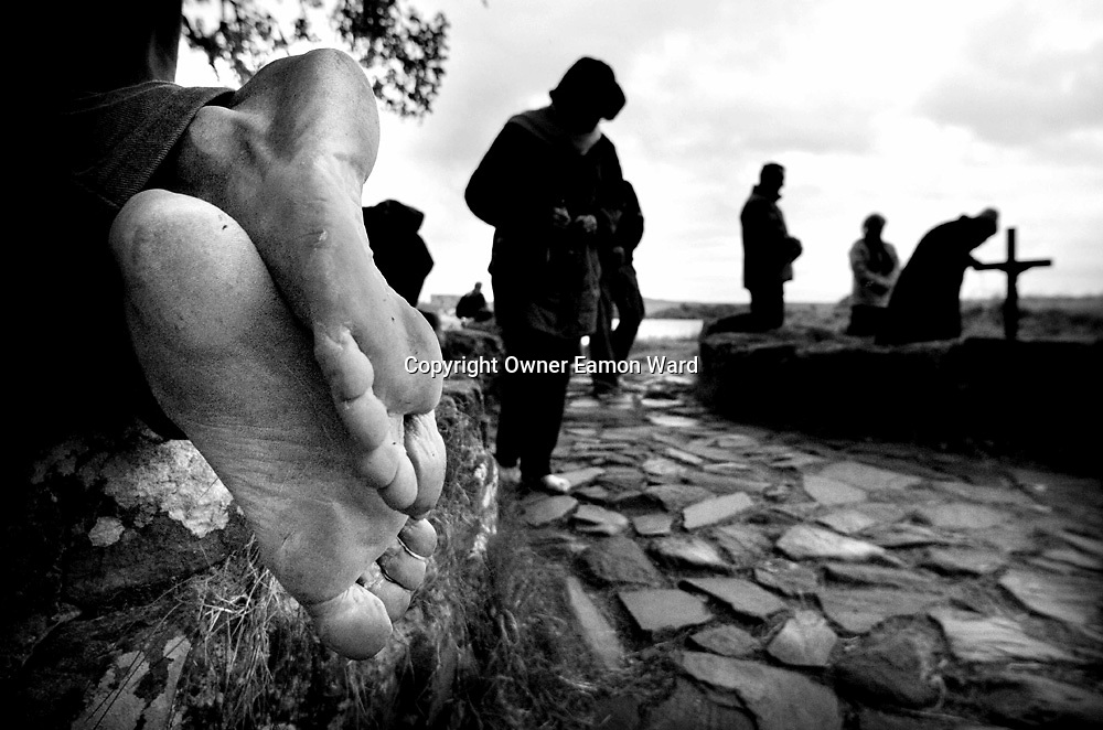 Lough Derg , Co Donegal,Ireland...Pilgrims take part in three days of Prayer ,Fasting and Barefoot rounds of penetential beds at St Patricks Purgatorial Island ,Co Donegal,Ireland...Photograph by Eamon Ward
