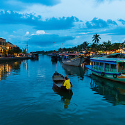 Boats on Thu Bon River, Hoi An at dusk