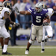 Kansas State running back Thomas Clayton (R) rushes up field for a first down against Missouri in the first quarter, at Bill Snyder Family Stadium in Manhattan, Kansas, November 19, 2005.  K-State defeated the Missouri Tigers 36-28.