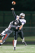Cedar Ridge quarterback Daryl Lydon gets harrassed by Bowie's Zachary Velasquez Friday at Burger Stadium in Austin.  (LOURDES M SHOAF for Statesman.)