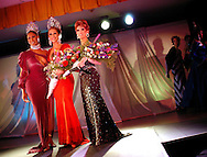NEW HOPE, PA - FEBRUARY 28:  Miss Gay USofA 2003 Raquell Lord (L), Miss Gay Pennsylvania USofA 2004 Angela Carrera (C), and Miss Gay Pennsylvania 2004 First Runner Up Lady Marissa (R) are applauded during the 12th Annual Miss Gay Pennsylvania USofA Drag Queen Pageant February 28, 2004 in New Hope, Pennsylvania. The winner of the Pennsylvania pageant won $500 and a trip to compete in the Miss Gay USofA 2004 Pageant in Dallas, Texas later this year. (Photo by William Thomas Cain/Getty Images)