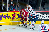 REGINA, SK - MAY 20: Mitchell Balmas #11 of Acadie-Bathurst Titan is checked by Cale Fleury #4 of Regina Pats at the Brandt Centre on May 20, 2018 in Regina, Canada. (Photo by Marissa Baecker/CHL Images)