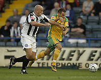 Photo: Aidan Ellis.<br /> Rochdale v Norwich City. Carling Cup. 28/08/2007.<br /> Norwich's Darren Huckerby is chased by Rochdale's Guy Branston