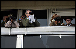 Princess Anne and the Duchess of Cornwall (right) watch the Queen Mother Champion Steeple Chase at the Cheltenham Festival Ladies Day at Cheltenham Racecourse, Cheltenham, United Kingdom. Wednesday, 12th March 2014. Picture by Andrew Parsons / i-Images