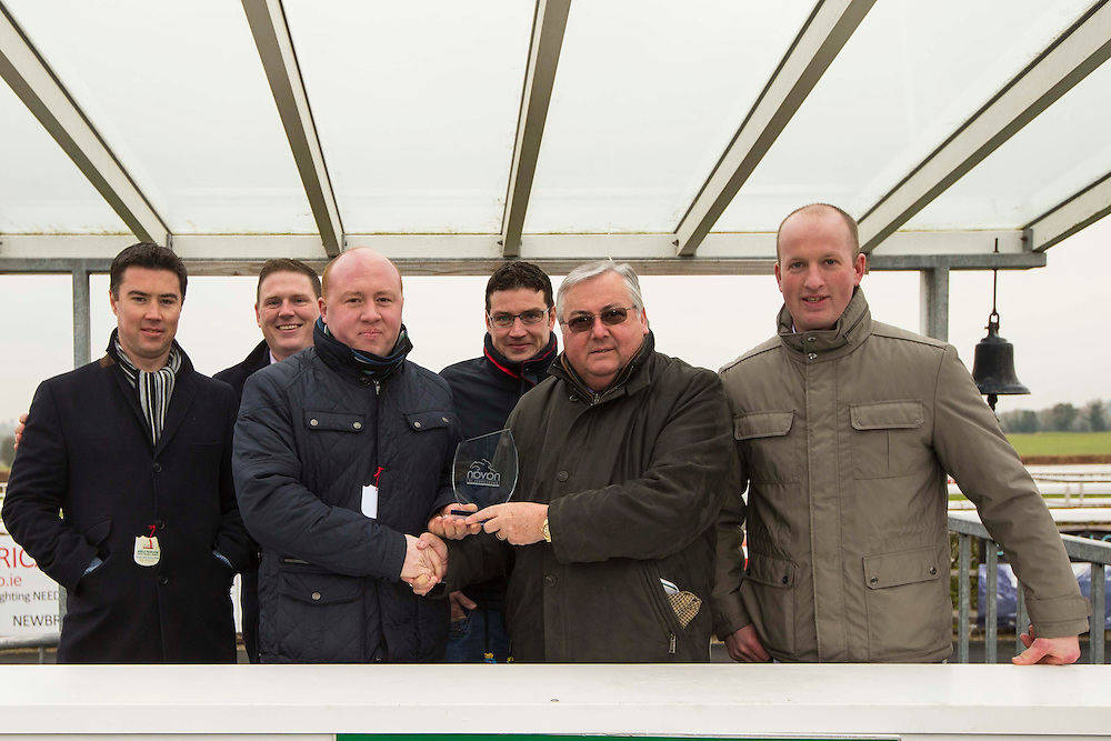 Navan Races, Saturday 27th February 2016.<br /> The Sideways syndicate from Moynalvey / Summerhill pictured after receiving the prize after Jury Duty won the Garlow Cross Handicap Hurdle at Navan<br /> L-R, Shane Collins, Giles Drum, David Gannon, Ciaran Collins, Jimmy Owens (Navan Racecourse), Barry McGann.<br /> Photo: David Mullen /www.cyberimages.net / 2016