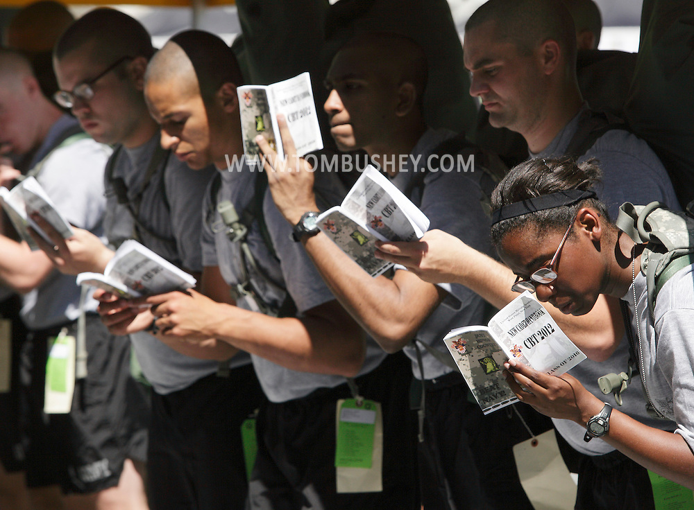 New cadets look at their Cadet Basic Training handbooks during Reception Day at the U.S. Military Academy at West Point on Monday, July 2, 2012.