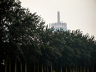 A new modern buliding looms above the Yuan Dynasty Rekics Park near the Olympic Village in Beijing China