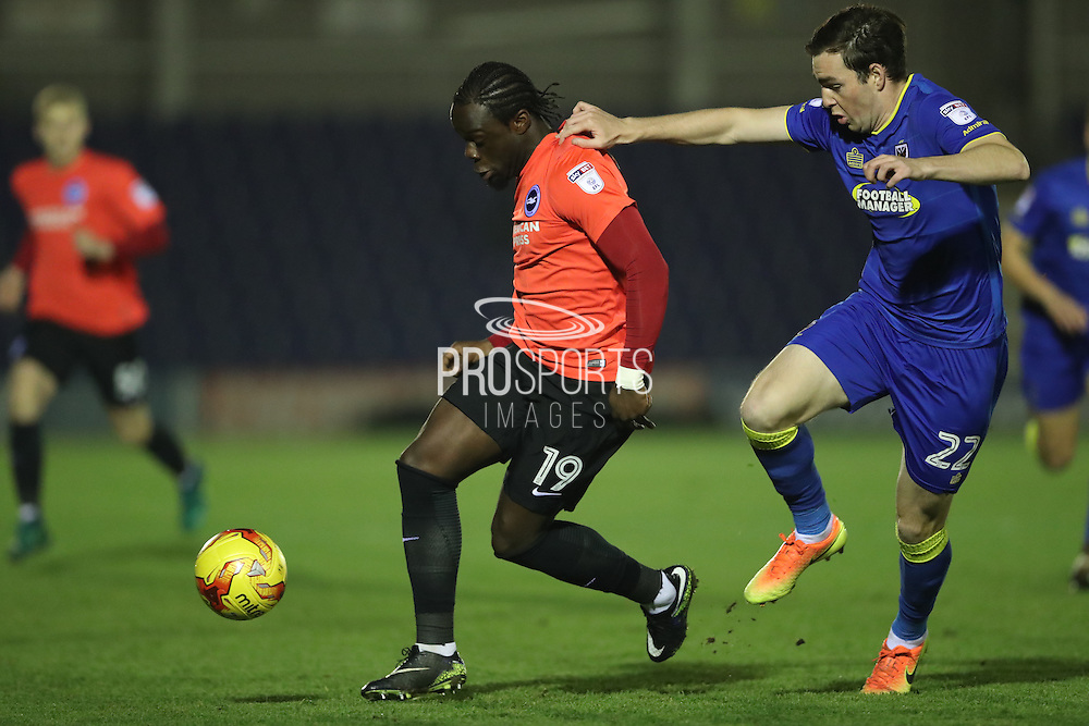 Brighton & Hove Albion centre forward Elvis Manu (19) and AFC Wimbledon defender Sean Kelly (22) during the EFL Trophy match between AFC Wimbledon and U23 Brighton and Hove Albion at the Cherry Red Records Stadium, Kingston, England on 6 December 2016.