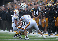 September 3, 2011: Tennessee Tech Golden Eagles cornerback Will Johnson (4) loses his helmet as he hits Iowa Hawkeyes quarterback James Vandenberg (16) as Tennessee Tech Golden Eagles linebacker Jake McIntosh (31) looks on during the first half of the game between the Tennessee Tech Golden Eagles and the Iowa Hawkeyes at Kinnick Stadium in Iowa City, Iowa on Saturday, September 3, 2011. Iowa defeated Tennessee Tech 34-7 in a game stopped at one point due to lightning and rain.
