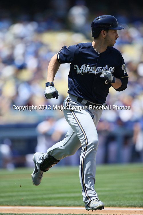 LOS ANGELES, CA - APRIL 28:  Ryan Braun #8 of the Milwaukee Brewers runs to first base as he hits a single that puts runners at first and third base in the top of the first inning during the game against the Los Angeles Dodgers on Sunday, April 28, 2013 at Dodger Stadium in Los Angeles, California. The Dodgers won the game 2-0. (Photo by Paul Spinelli/MLB Photos via Getty Images) *** Local Caption *** Ryan Braun