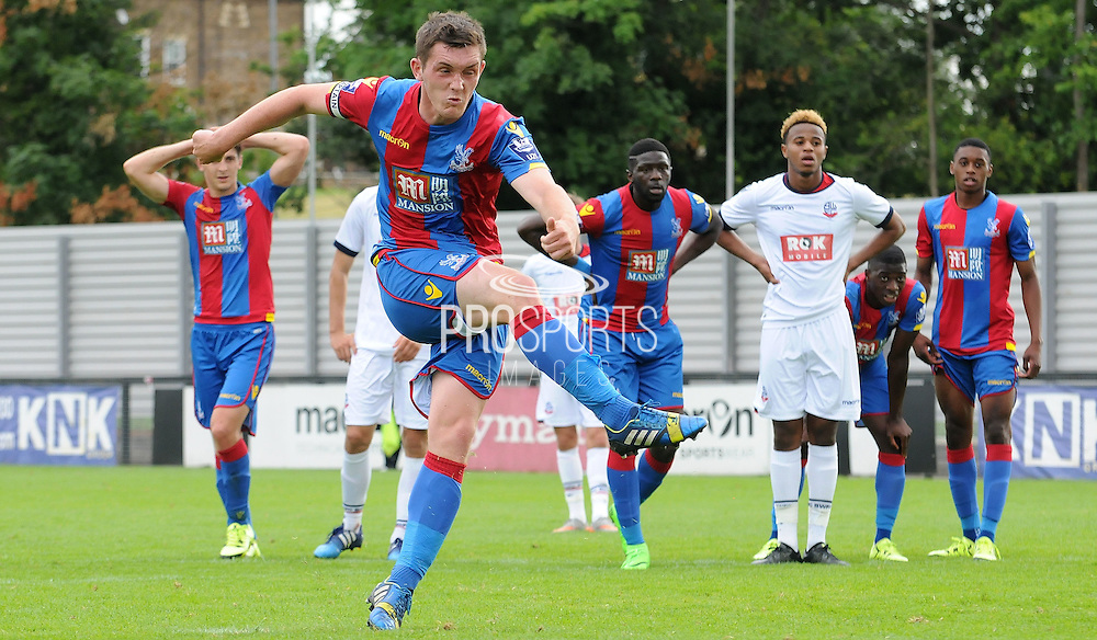 Connor Dymond fires in Palace's equaliser from the spot during the U21 Professional Development League match between U21 Crystal Palace and U21 Bolton Wanderers at Selhurst Park, London, England on 17 August 2015. Photo by Michael Hulf.