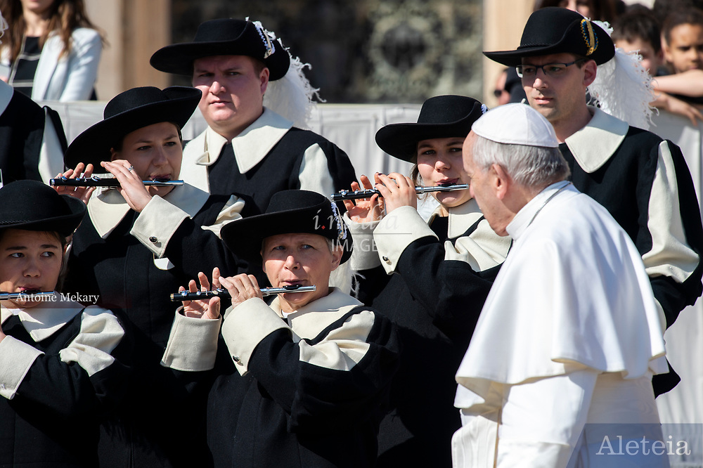 "Vatican City - MARCH 06, 2019: Members of the Fribourg-based Swiss Society of Fife and Drums ""La Bertholdia"" plays for Pope Francis at the end of his weekly general audience in St. Peter's Square at the Vatican."