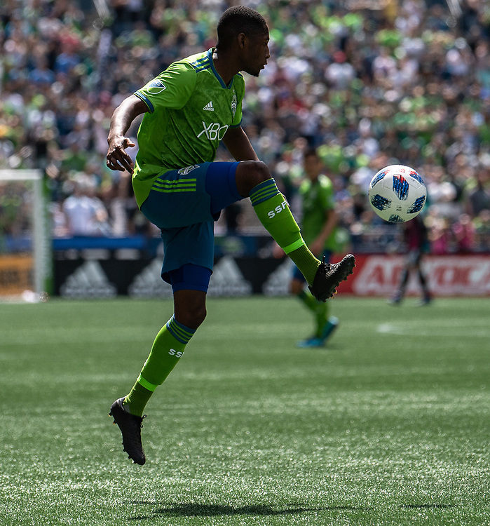 May 05, 2018; Seattle, Washington, US; Seattle Sounders defender Kelvin Leerdam (18) brings the ball down during in action between the Seattle Sounders FC and Columbus Crew at Century Link Field. Photo credit: Rick May - Rick May Photography