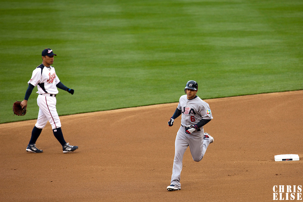 22 March 2009: #6 Brian Roberts of USA runs the bases passing by #8 Akinori Iwamura of Japan after hitting a solo homerun in the first inning during the 2009 World Baseball Classic semifinal game at Dodger Stadium in Los Angeles, California, USA. Japan wins 9-4 over Team USA.
