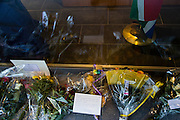 Brussels Belgium 6th December 2013. At the South African Embassy in Brussels people gather, Nelson Mandela died just yesterday.Flowers and texts at the window of the embassy