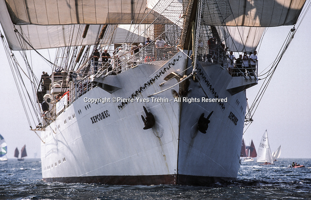 Ukrainian full-rigged square tall ship Khersones arriving Douarnenez. Surrounded by an armada of nearly 2,500 ships, the three-mast training barque still sported in 2000 a white steel hull 119m long